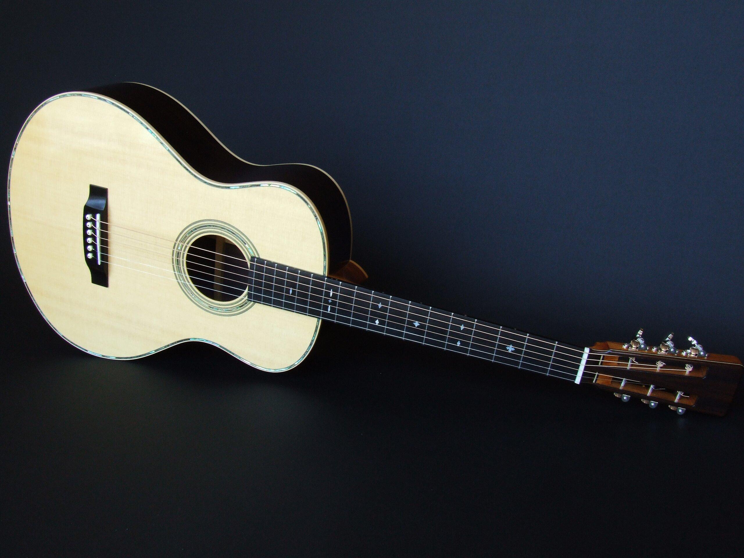 Full length shot of a medium retro guitar