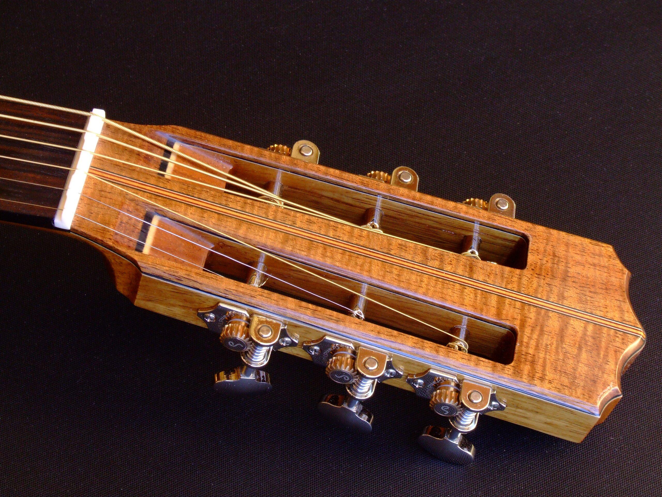Slot headstock on a steel string guitar