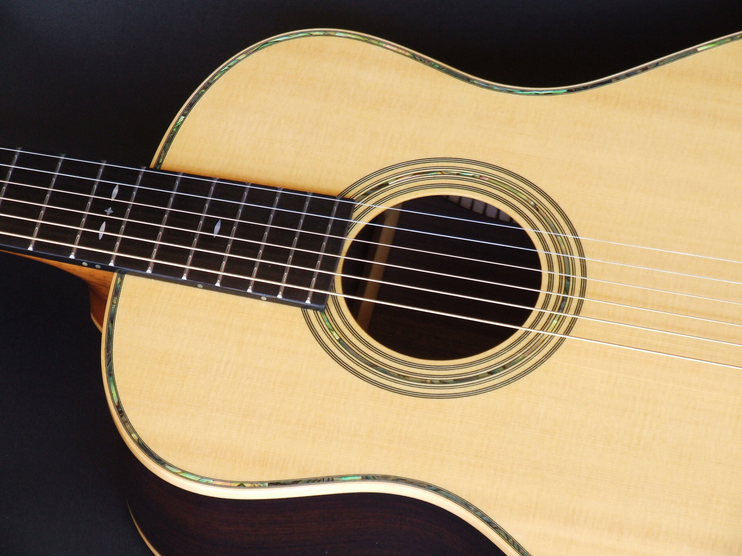 Rosette and abalone purfling on a medium retro sized guitar by Trevor Gore