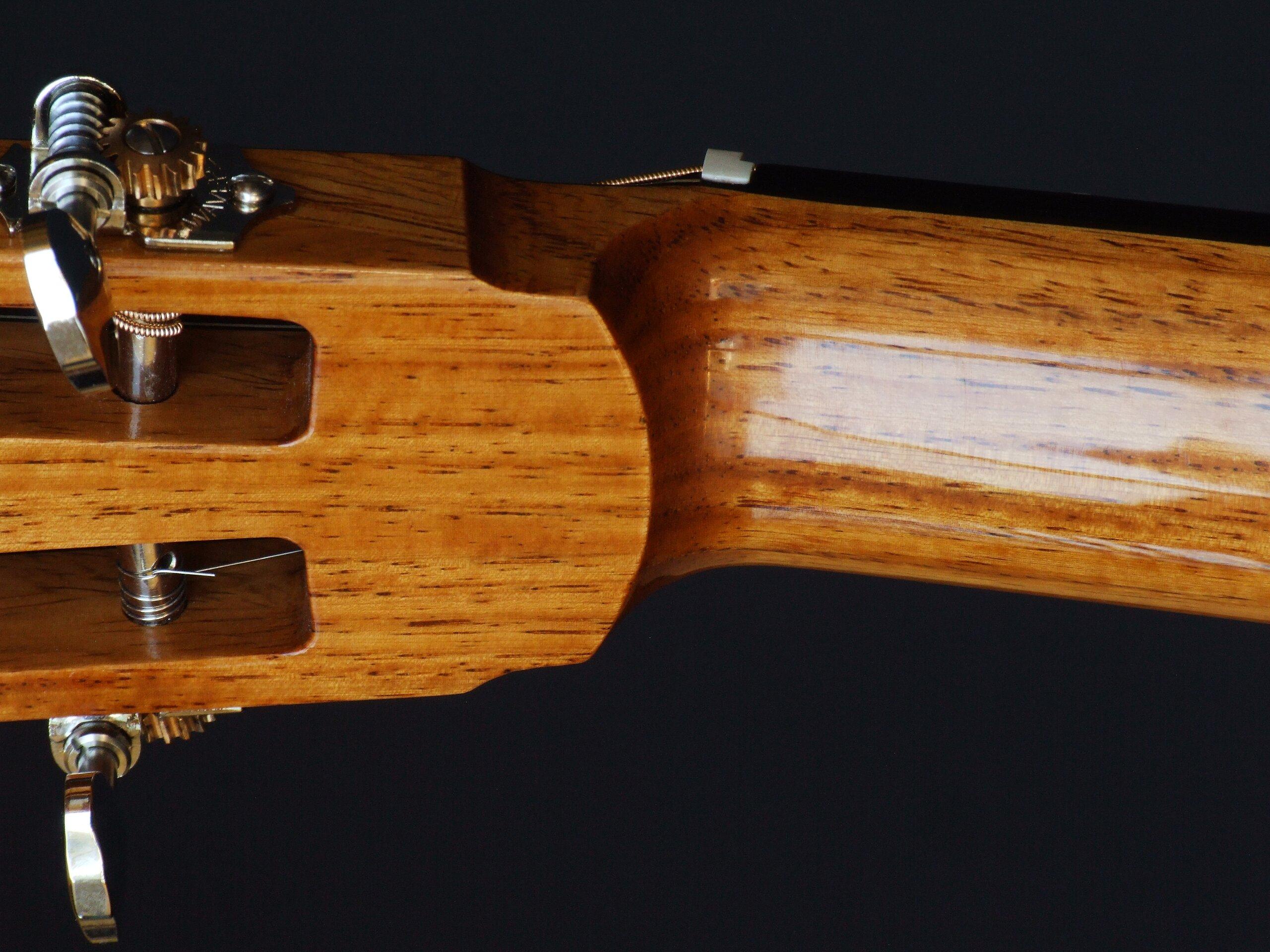 Throat of a slot-head steel string guitar