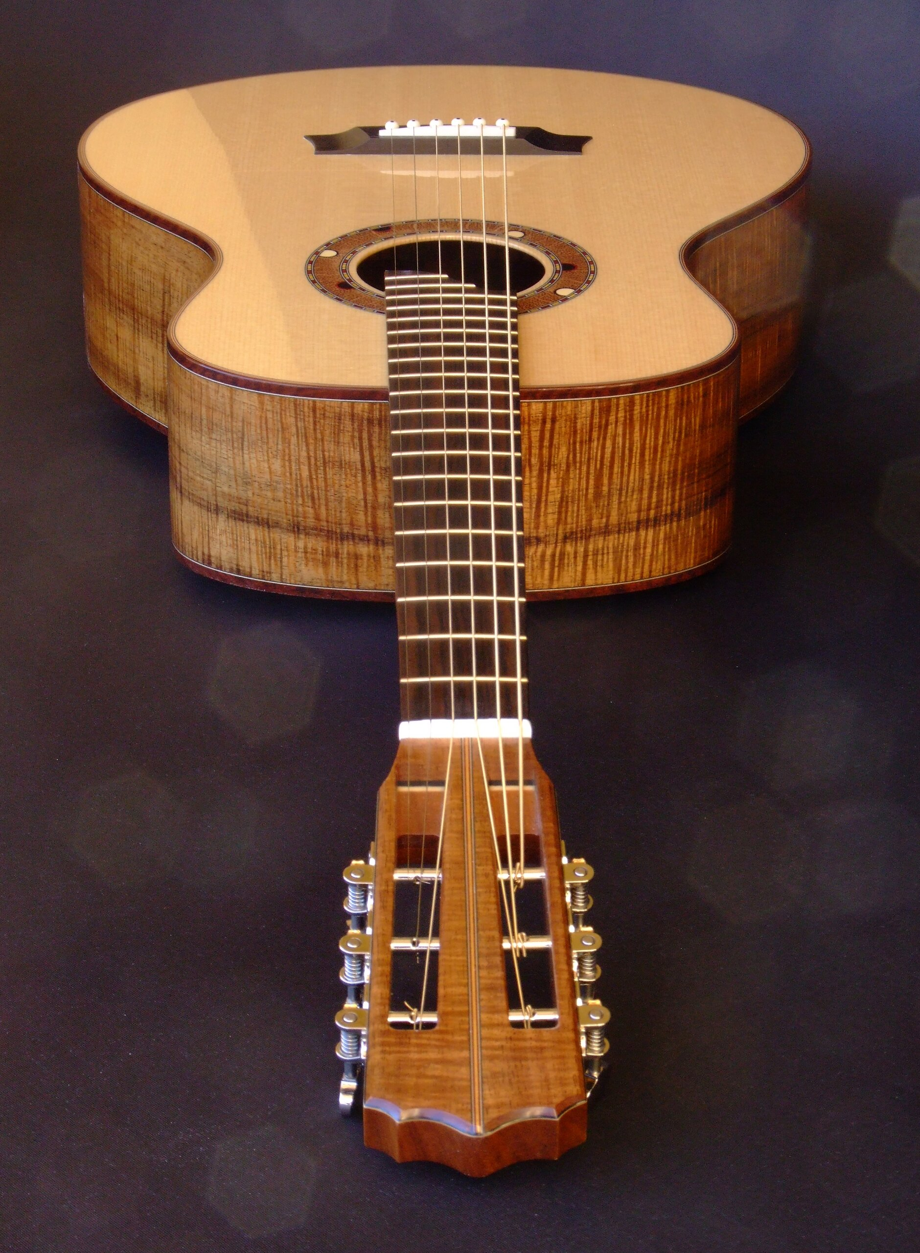 Looking down the neck of a blackwood classical guitar