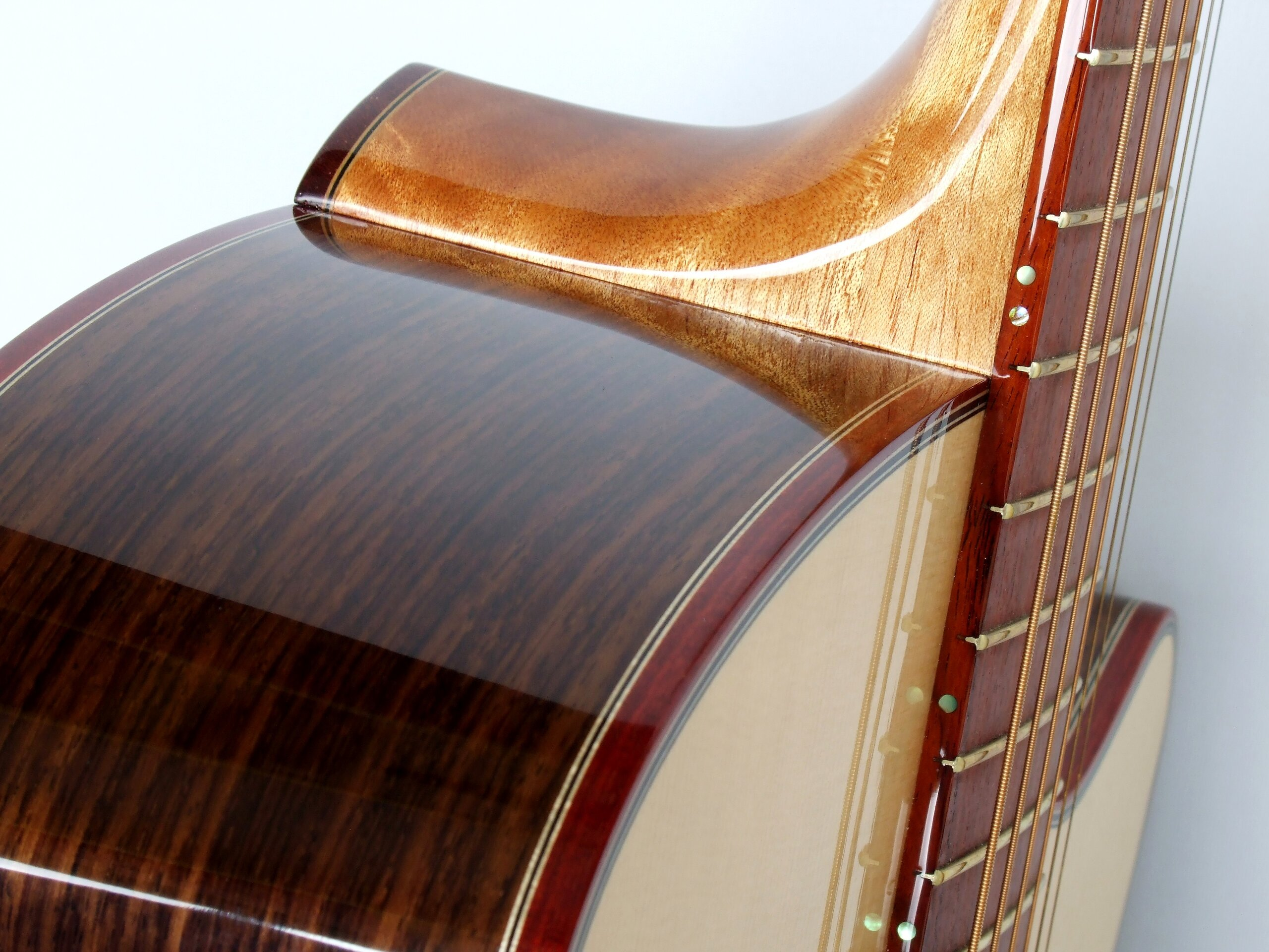 Detail of a neck joint on a steel string guitar