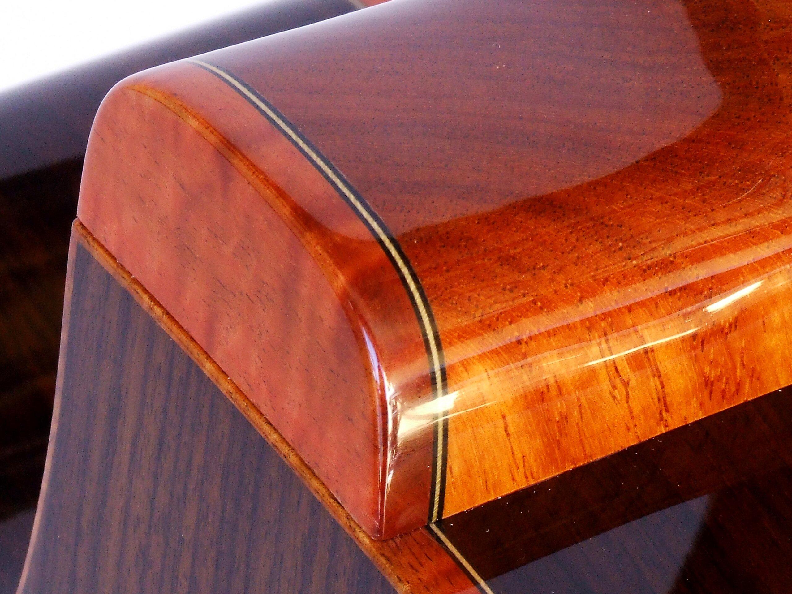 Detail of the heel cap on a steel string cutaway guitar