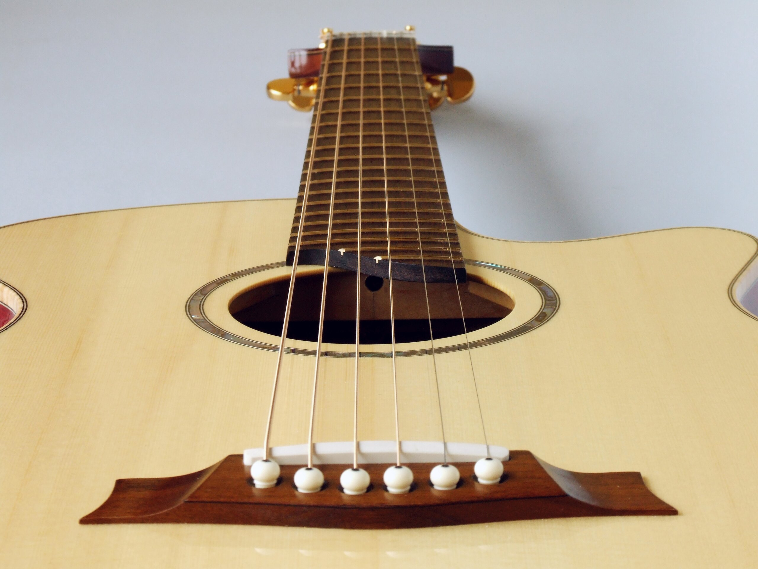 View from the bridge of a spruce top steel string guitar