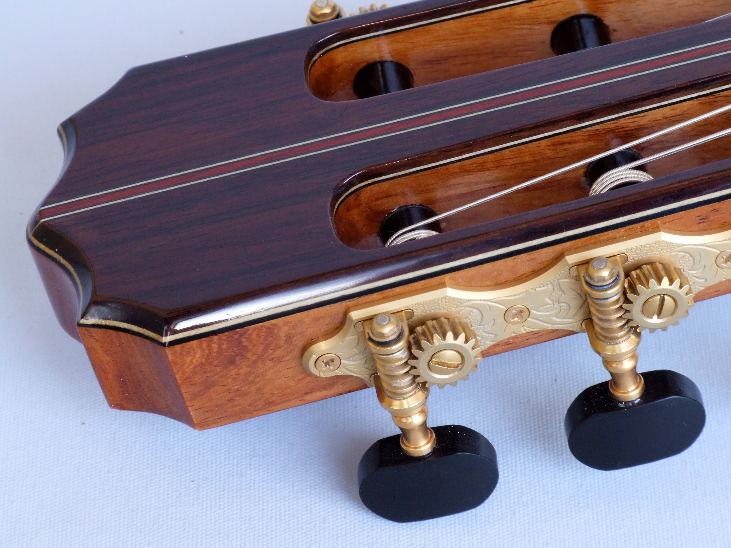 Detail of Gotoh tuners with ebony buttons on a classical guitar