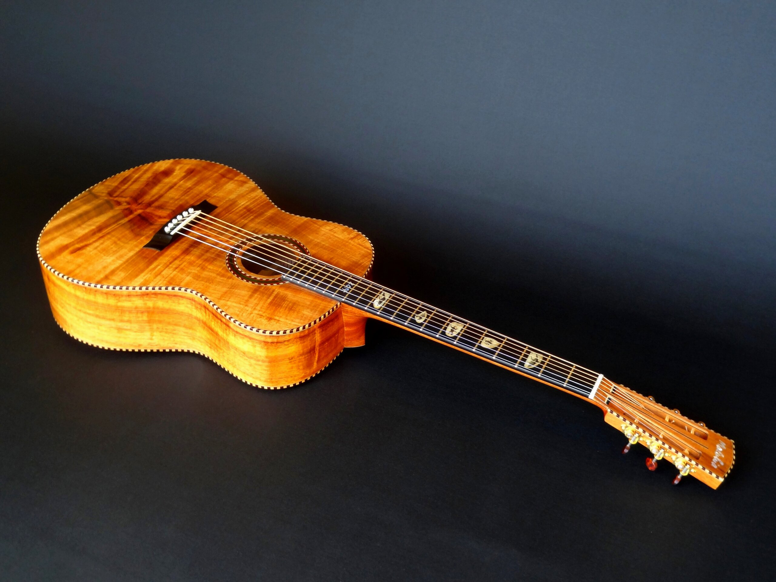 Koa guitar shown full length