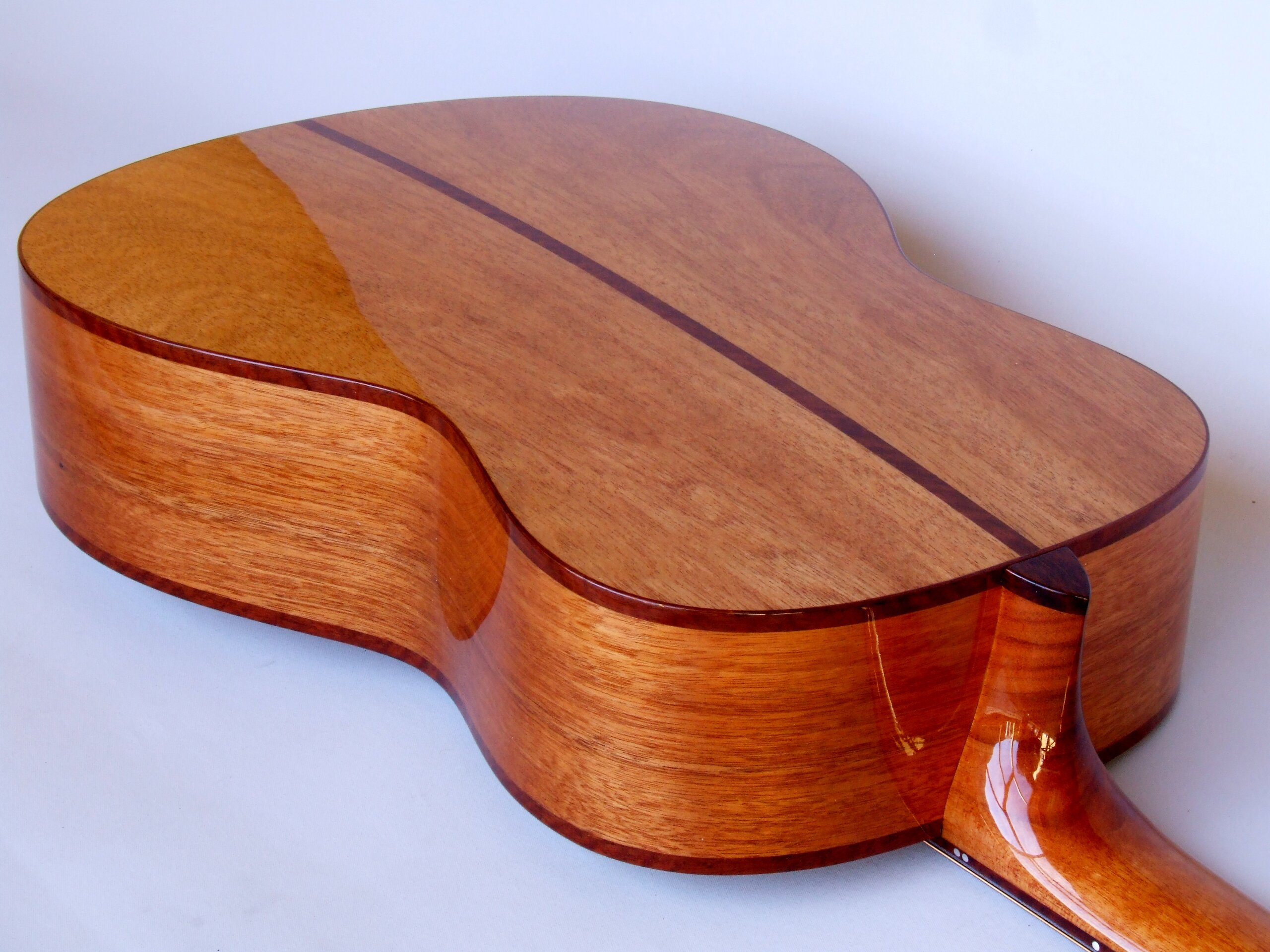 Figured Jarrah decorating the back and sides of the Shed guitar