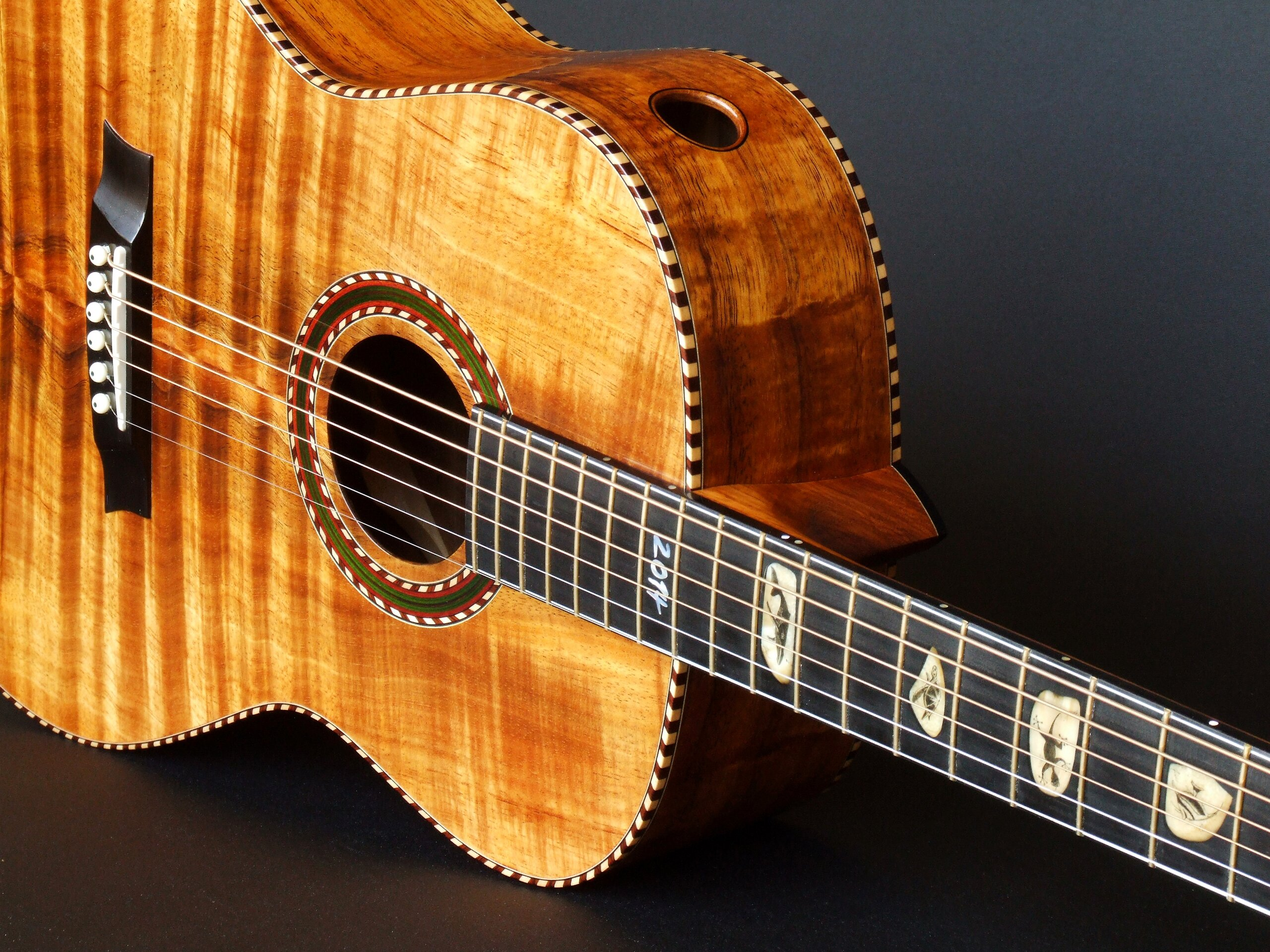 Gore all Koa guitar, rope binding, scrimshaw fret markers and sound port