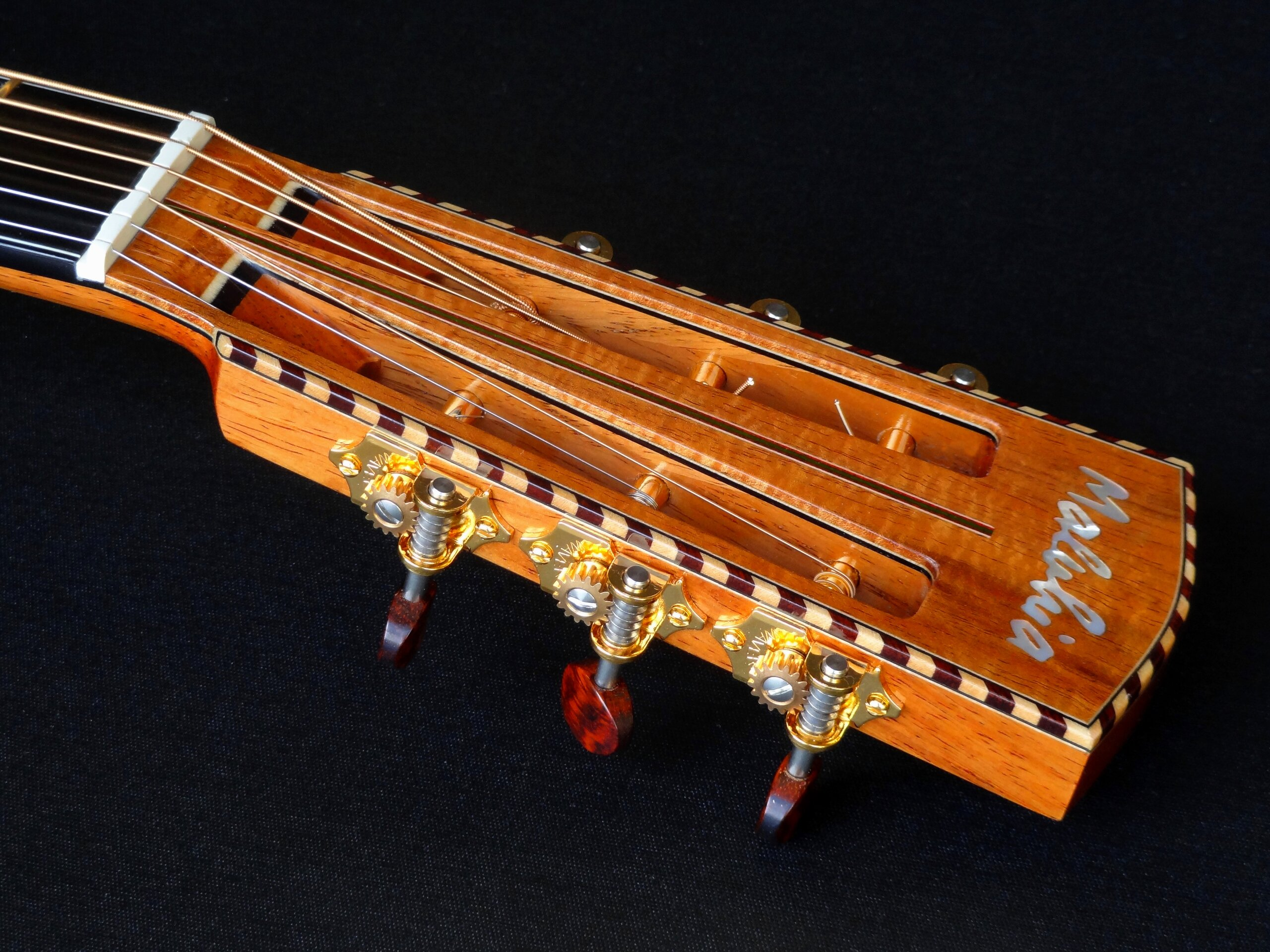 Slot headstock with rope binding, pearl inlay, Waverly tuners