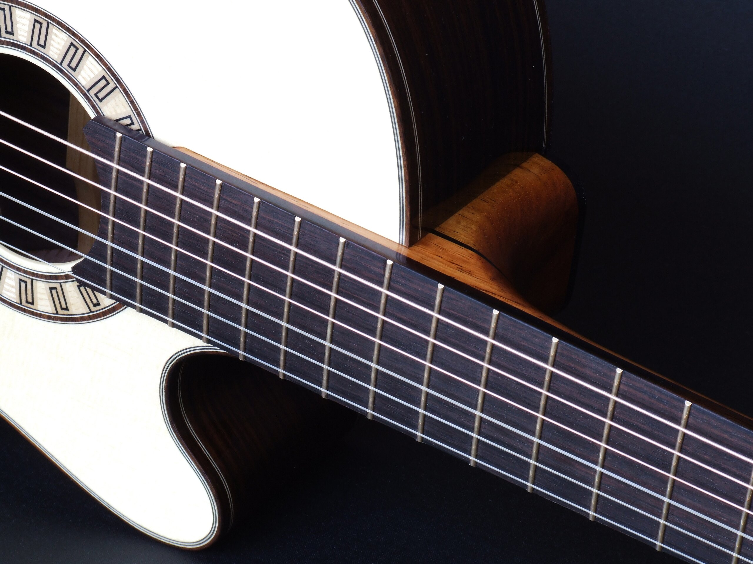 Tilt neck joint on a cutaway classical guitar