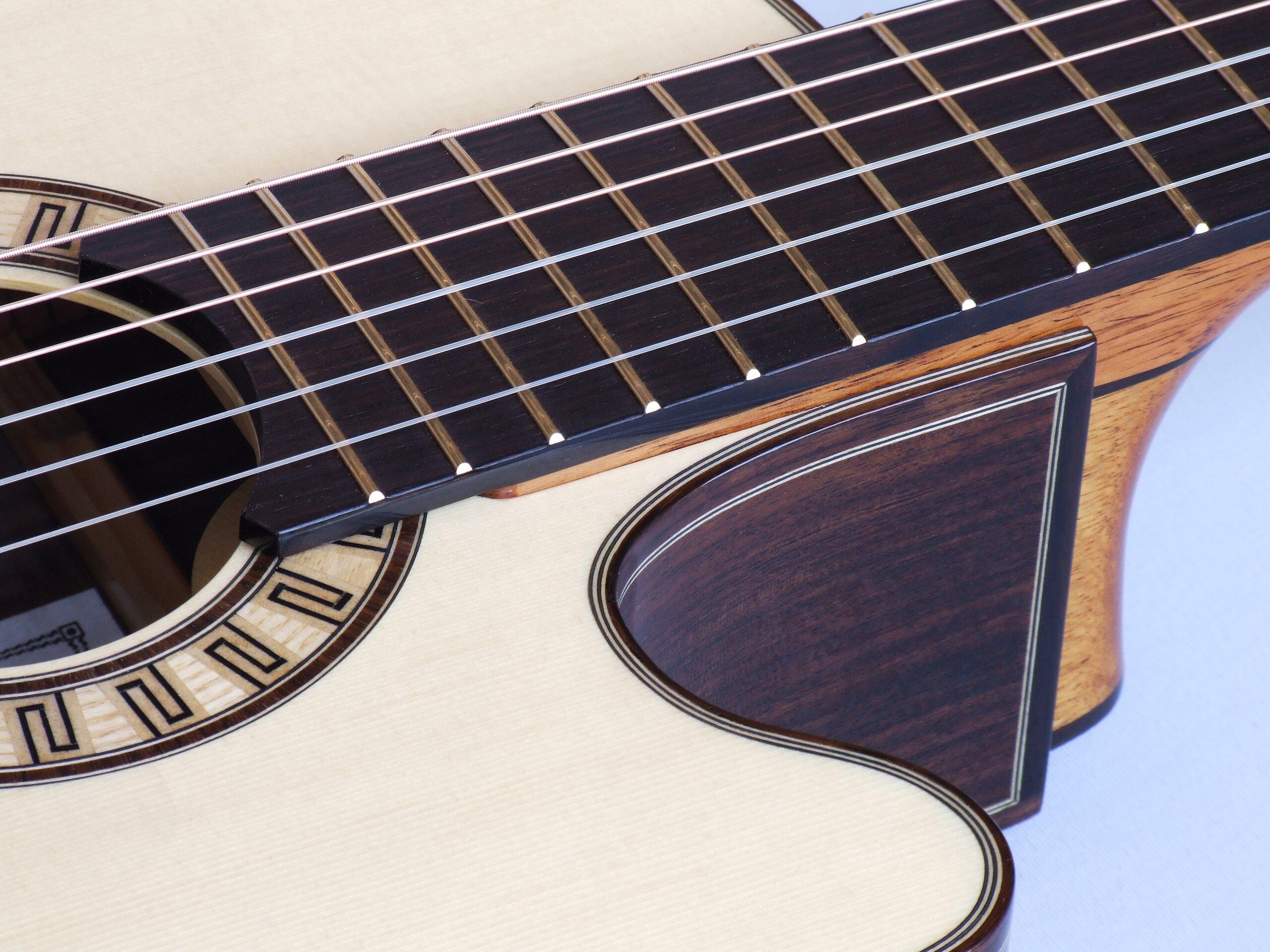 Neck joint on a Gore smallbody cutaway tilt-neck classical guitar