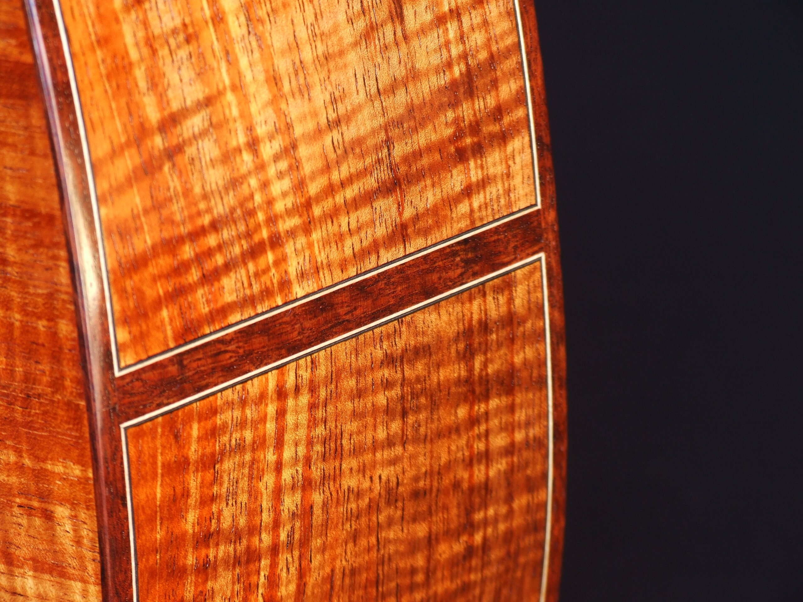 Jarrah butt inlay on a guitar with figured Australian blackwood back and sides