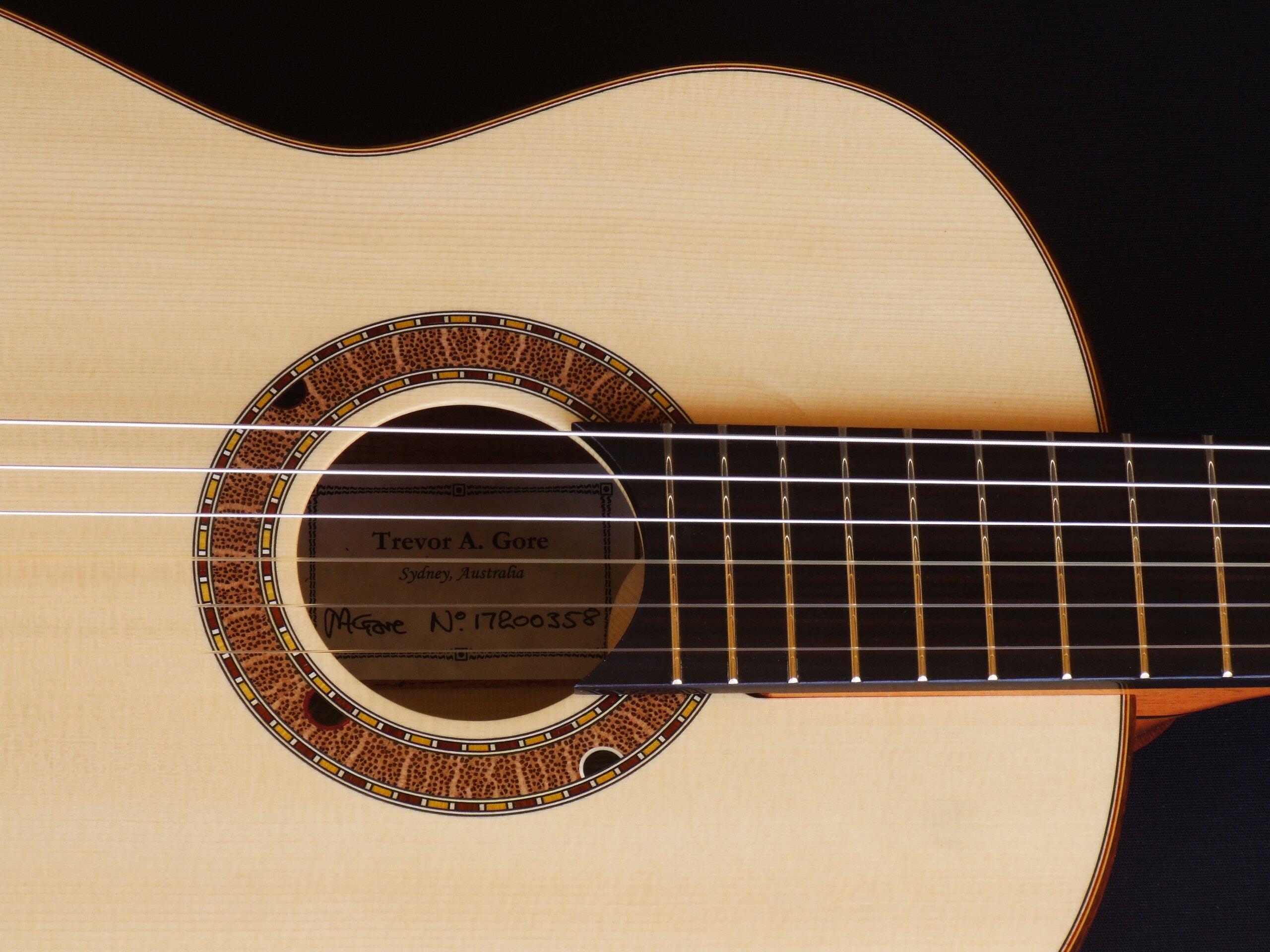 Australiana rosette on a small body tilt neck classical guitar