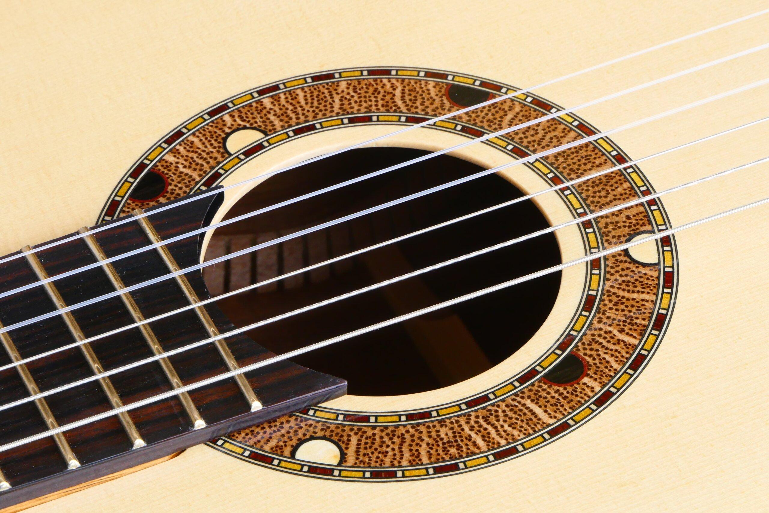 Australiana rosette in a spuce topped tilt-neck classical guitar