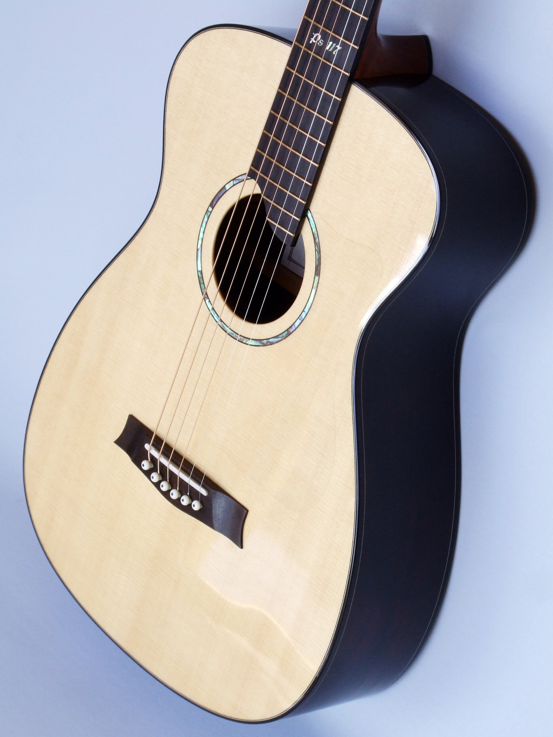 Small body steel string guitar with Lutz spruce top and Brazilian rosewood back and sides
