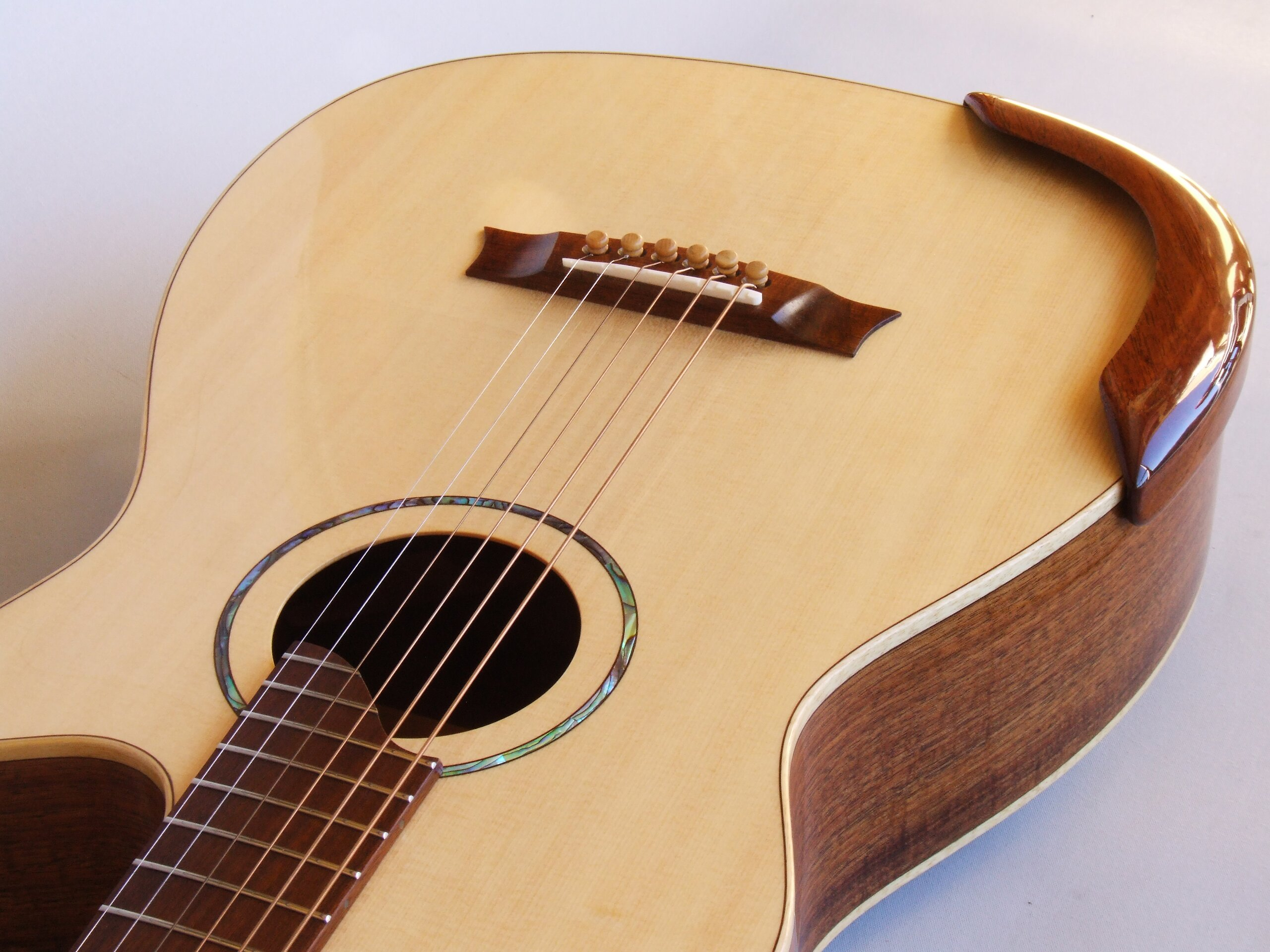 Small body steel string cutaway guitar with arm rest