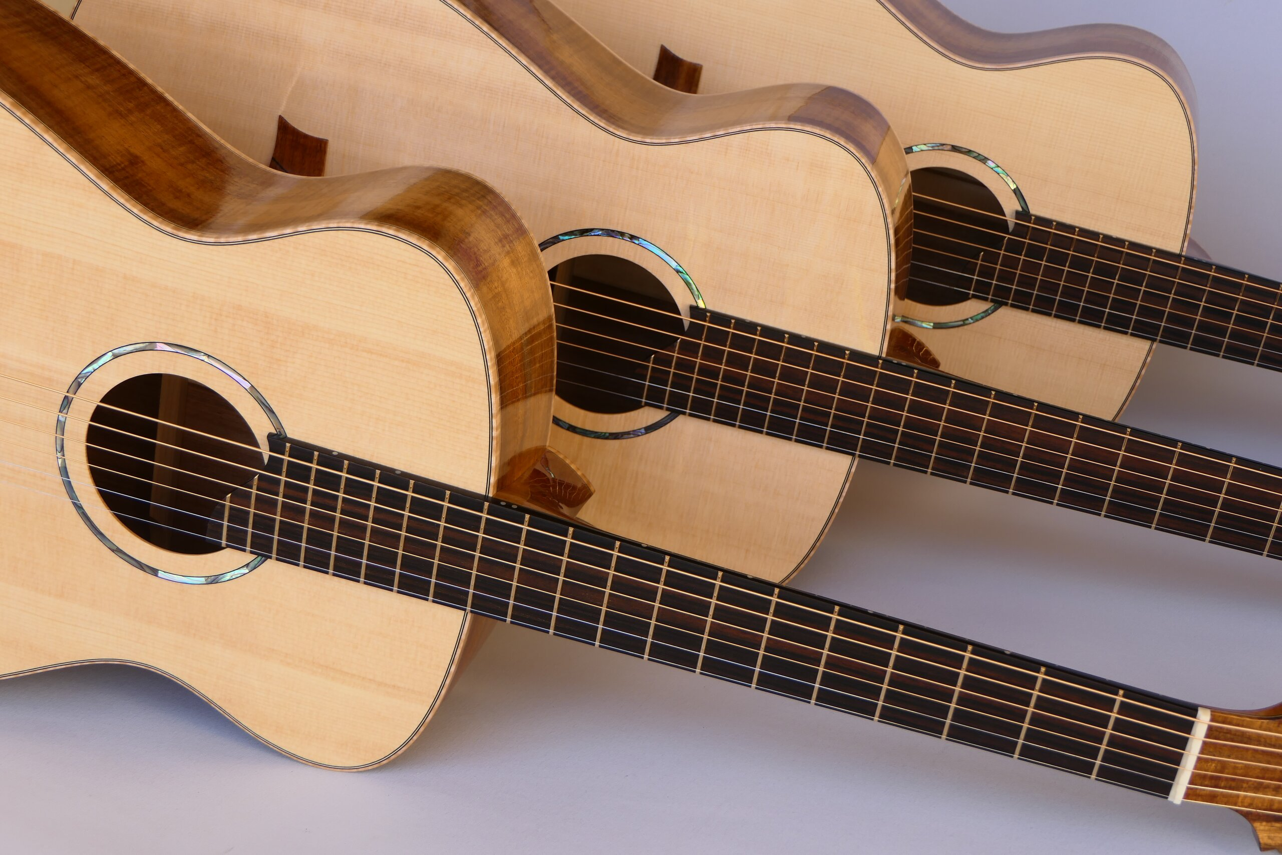 Matched set of three small body steel string guitars