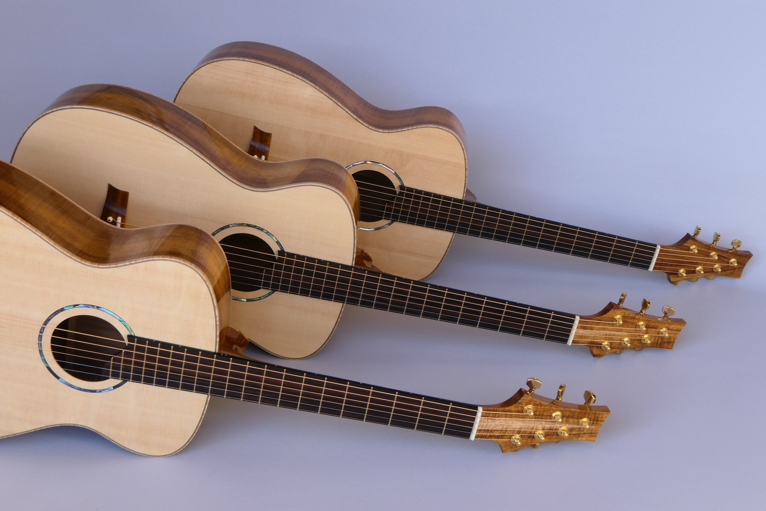Matched set of three small body steel string guitar by Trevor Gore