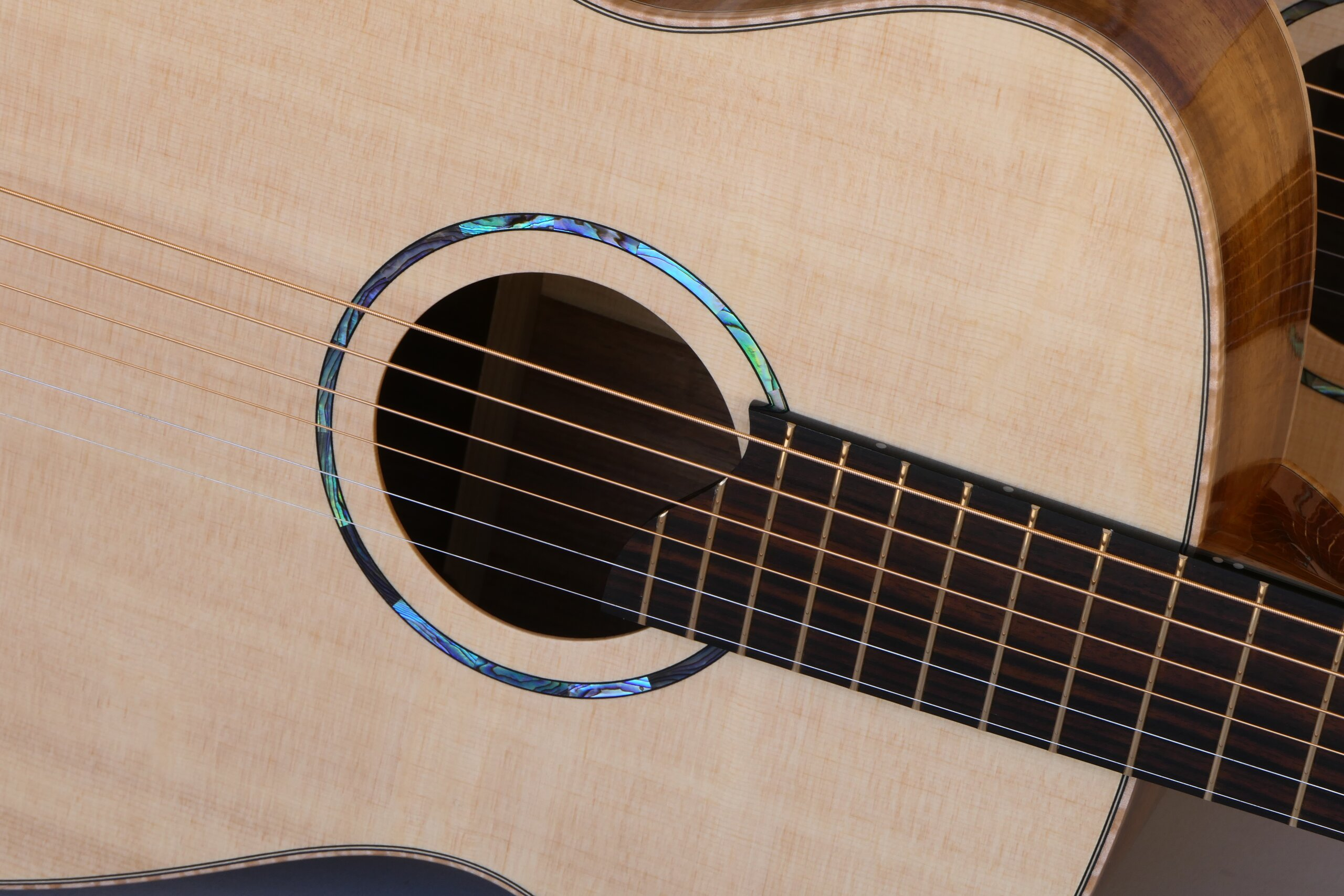Small body steel string guitar with simple paua rosette