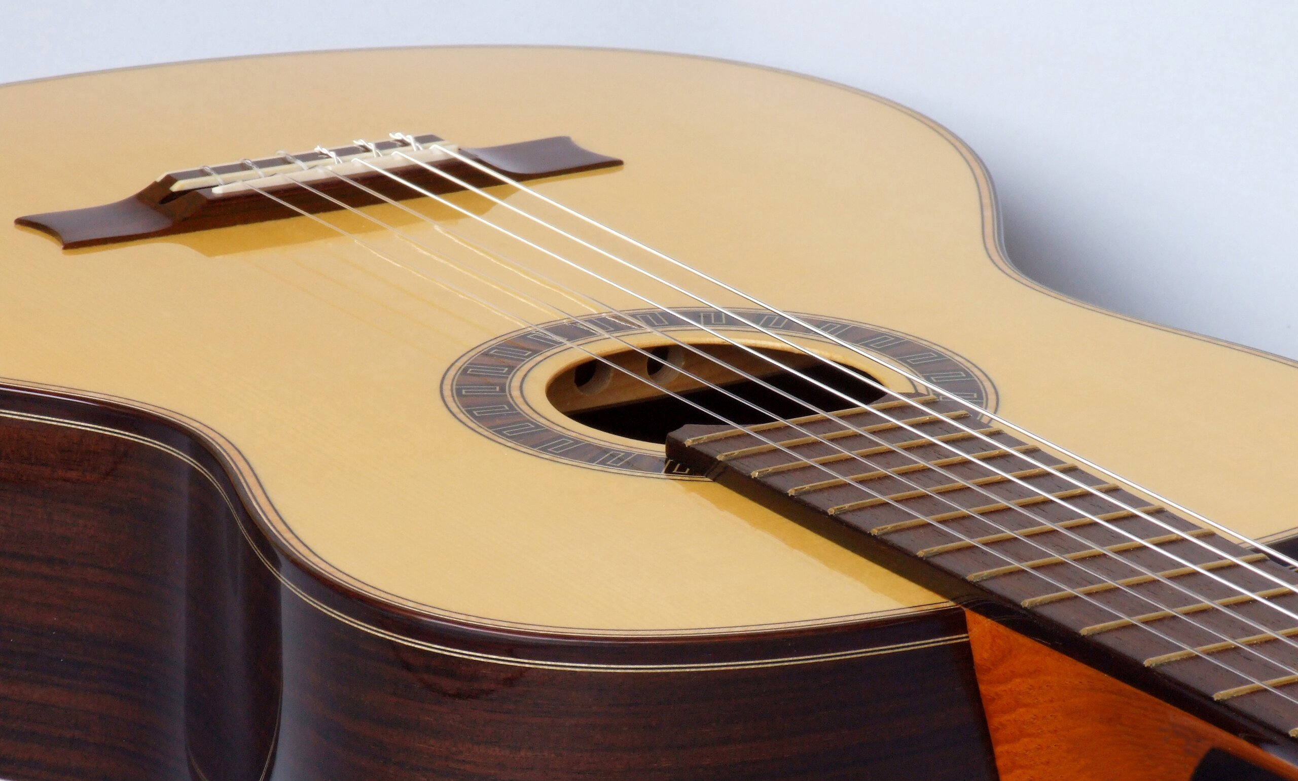 Classical guitar with spruce top and meander rosette