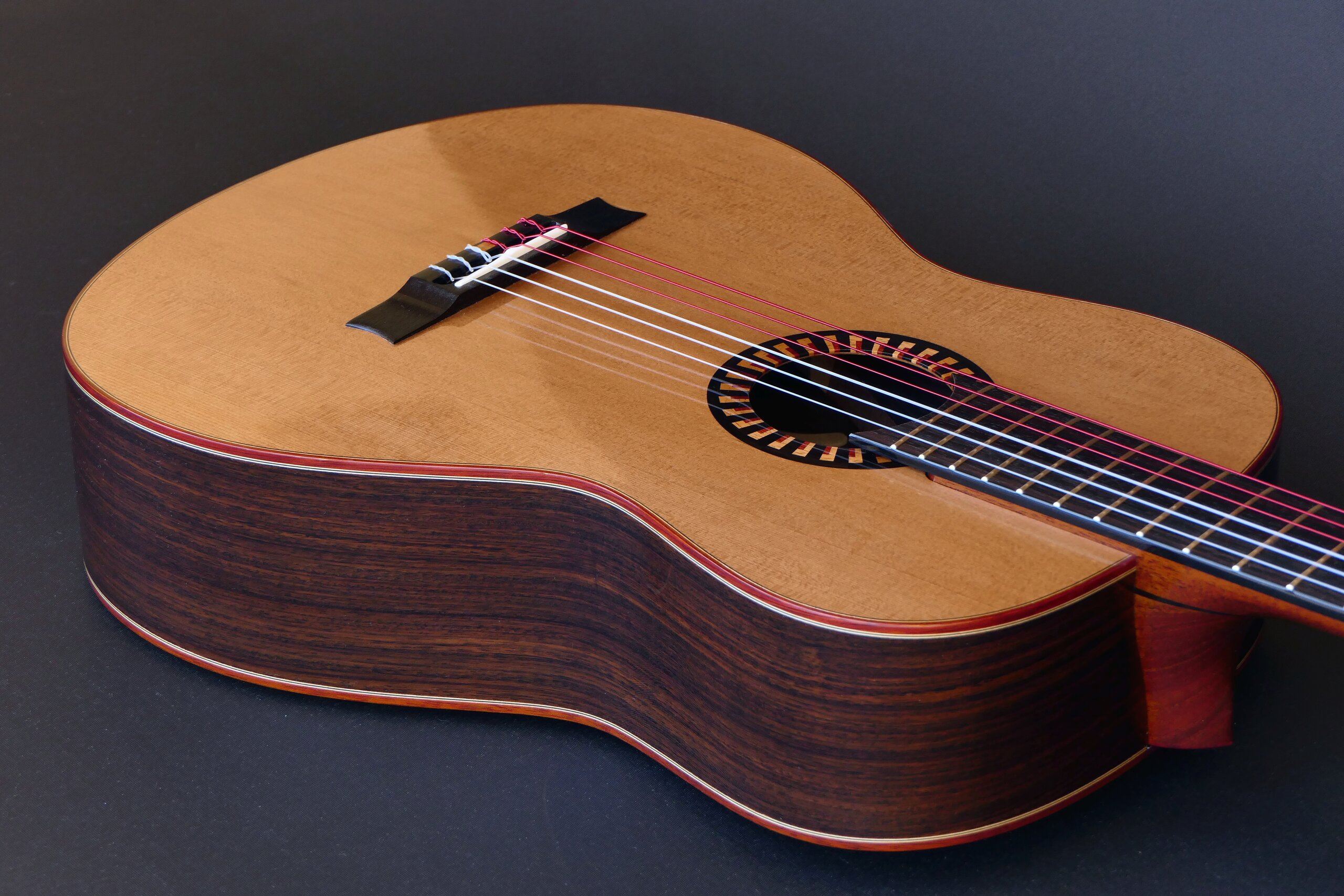 Classical guitar with cedar top, rosewood sides, bloodwood binding