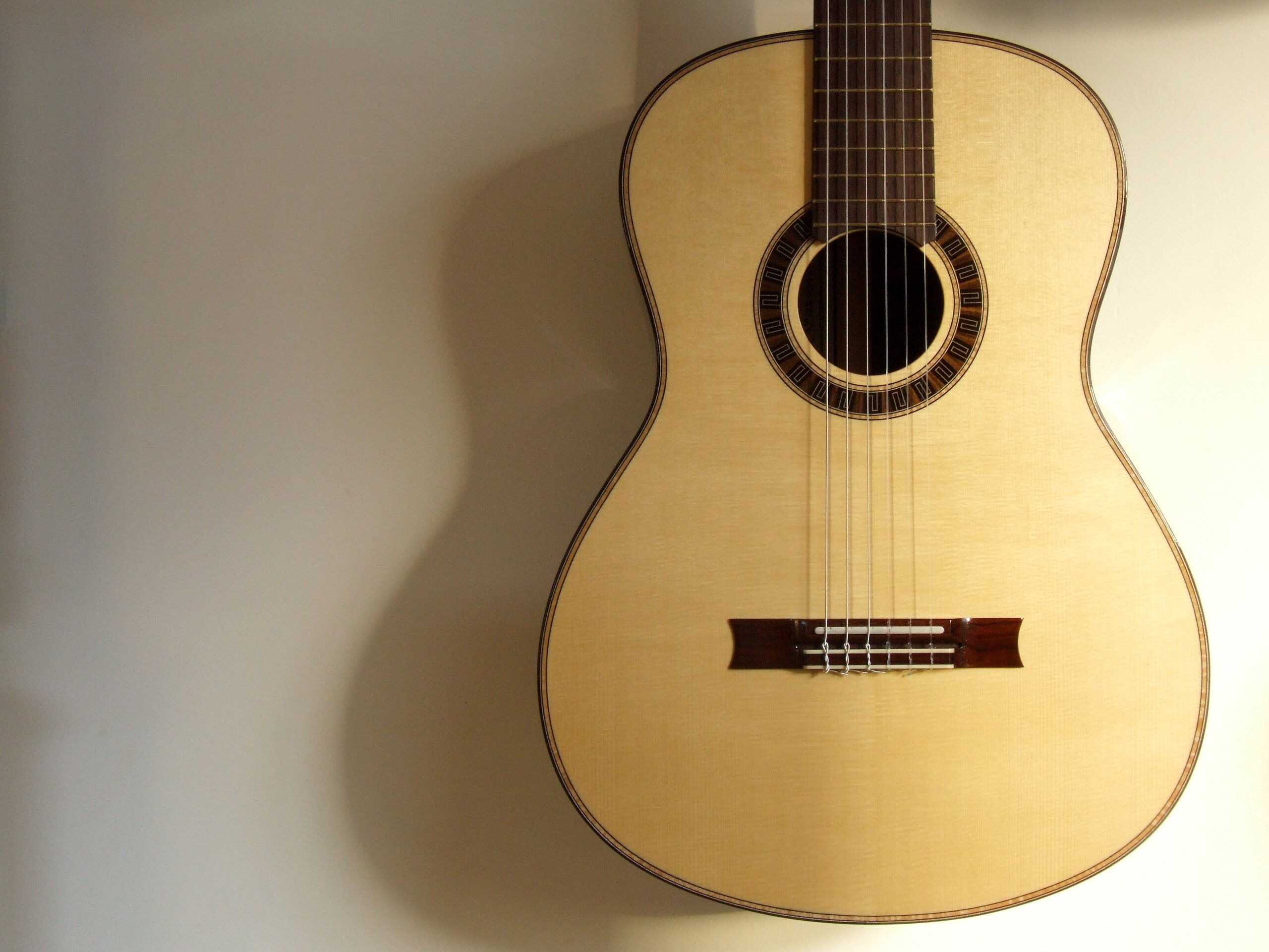 Spruce topped classical guitar with meander rosette