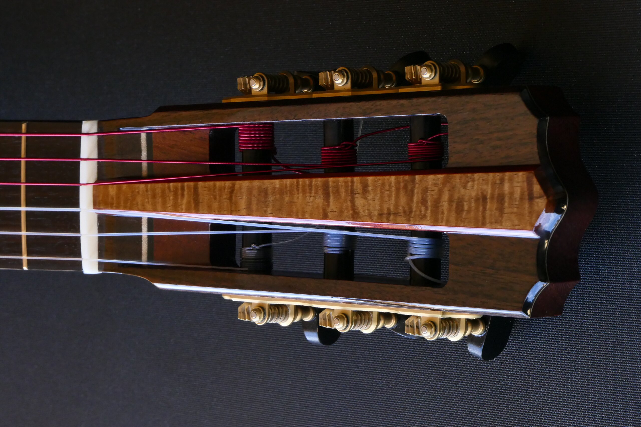 Classical guitar headstock with raised centre panel