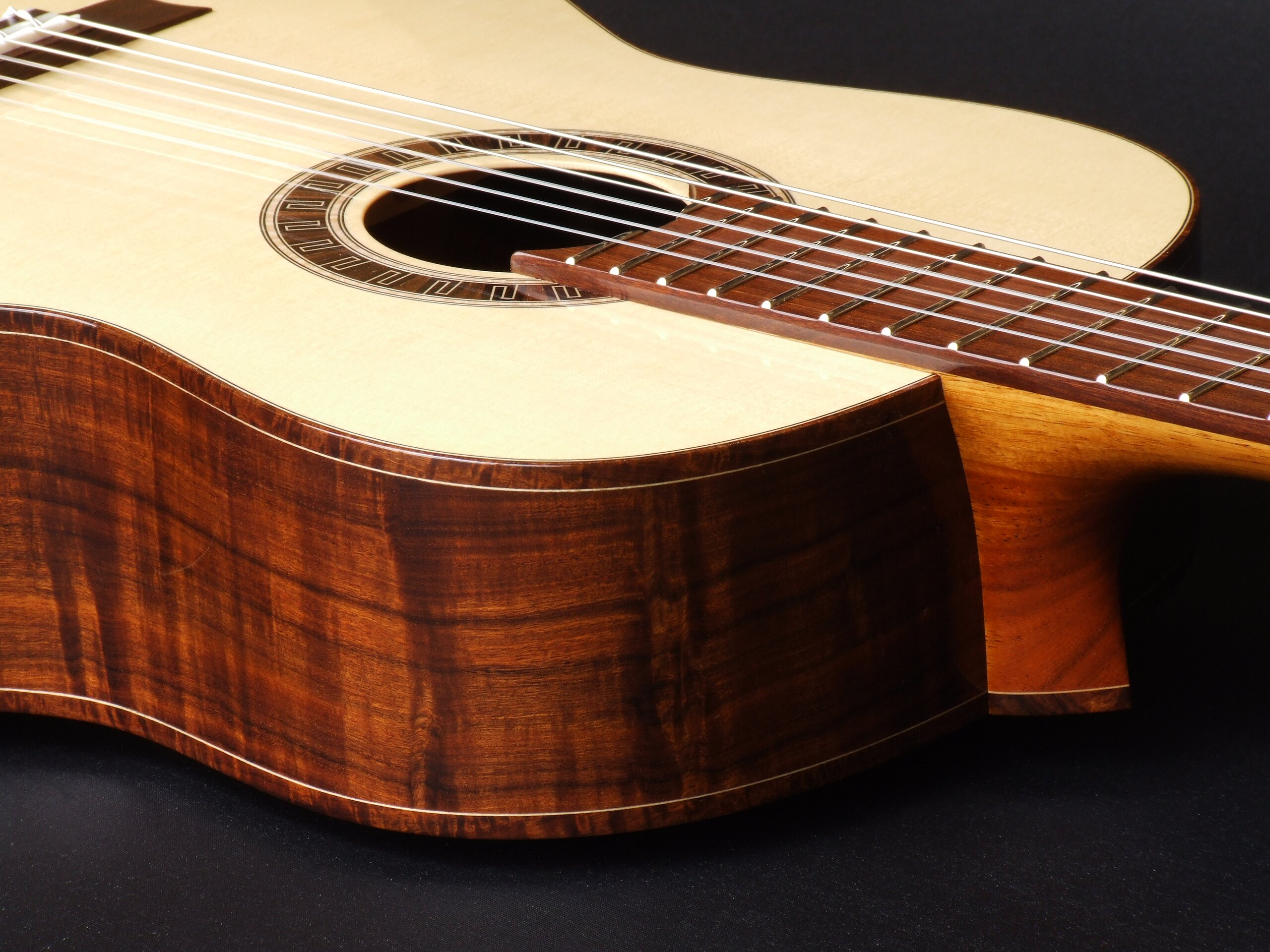 Neck joint on a gidgee bodied classical guitar by Trevor Gore