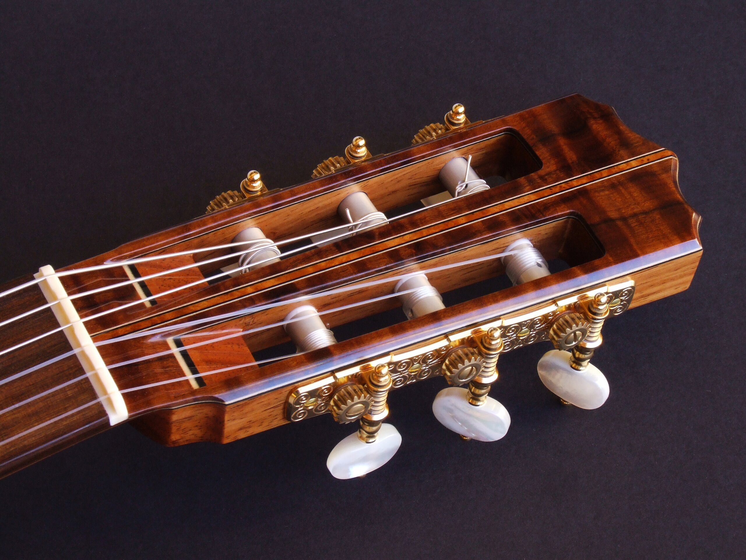 Gidgee faced classical guitar headstock with Gotoh tuners and pearl buttons