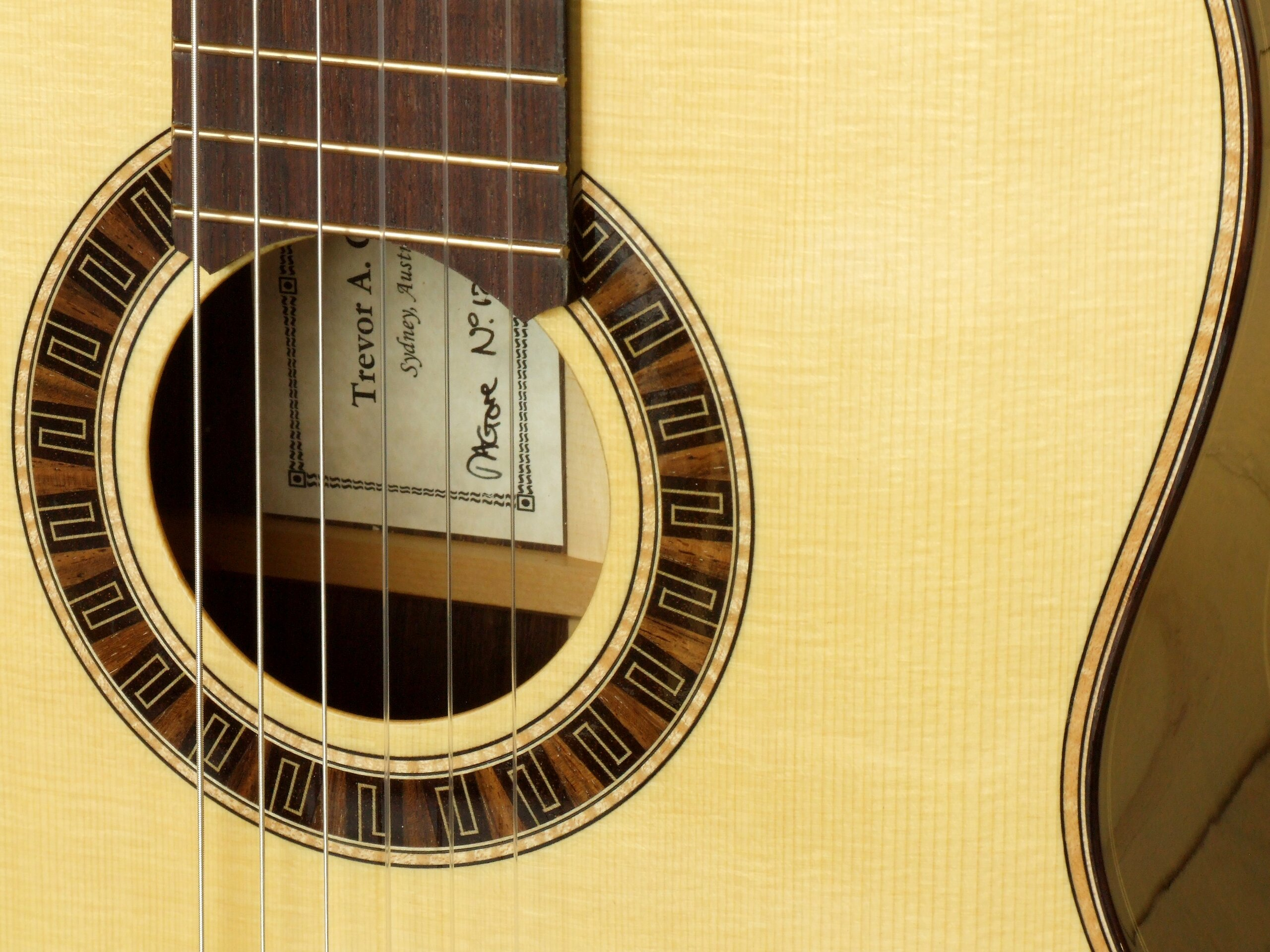 Meander rosette, figured maple purfling in a spruce topped Gore classical guitar