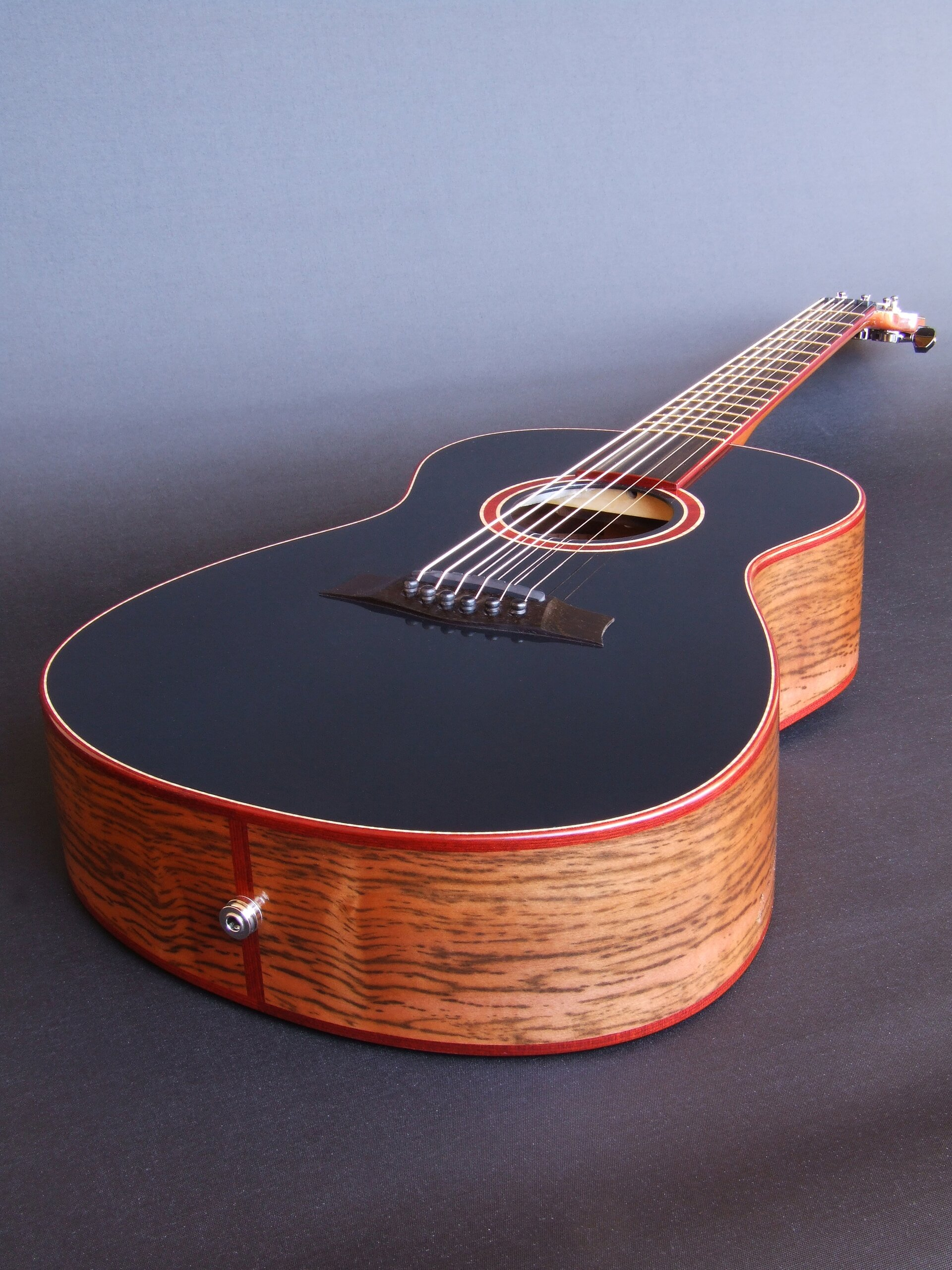 Black topped tiger mytle bodied super-parlor wedged guitar